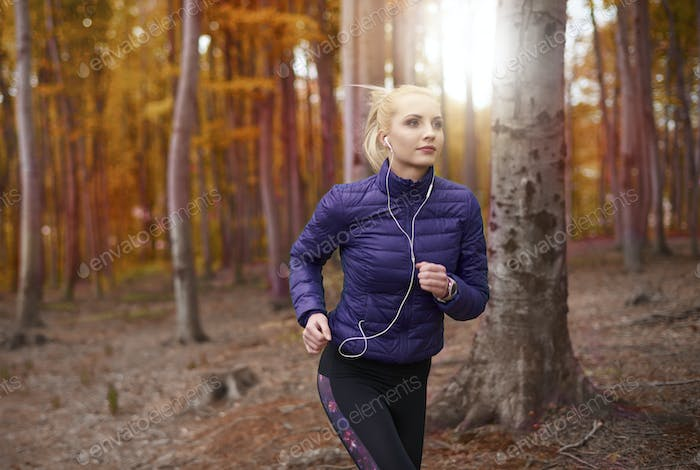 Jogging in the forest in the autumnal time