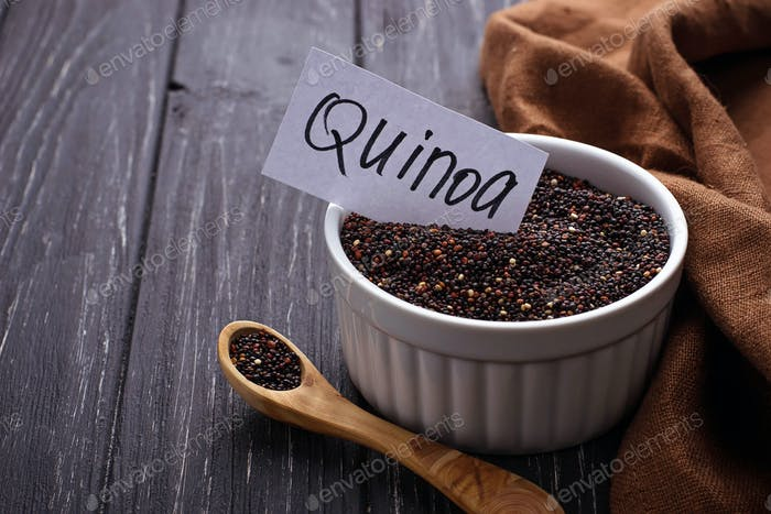 Uncooked black quinoa in bowl