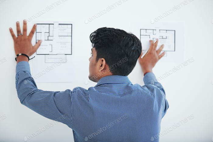 Architect examining plans of apartments