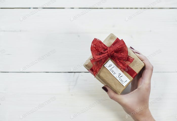 Holding gift for beloved person
