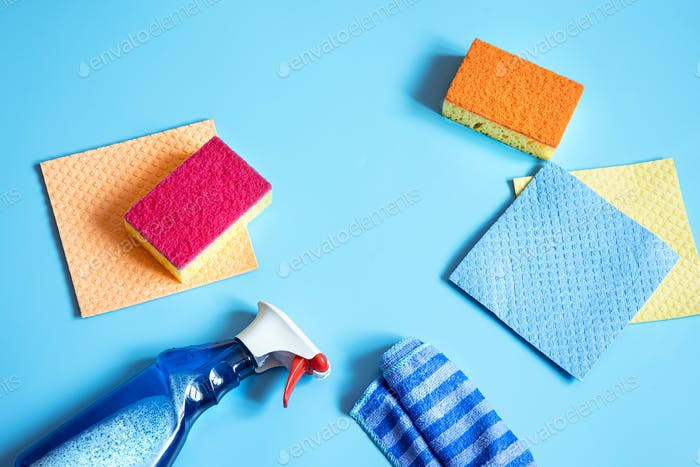 Colorful composition with home cleaning kit flat lay.