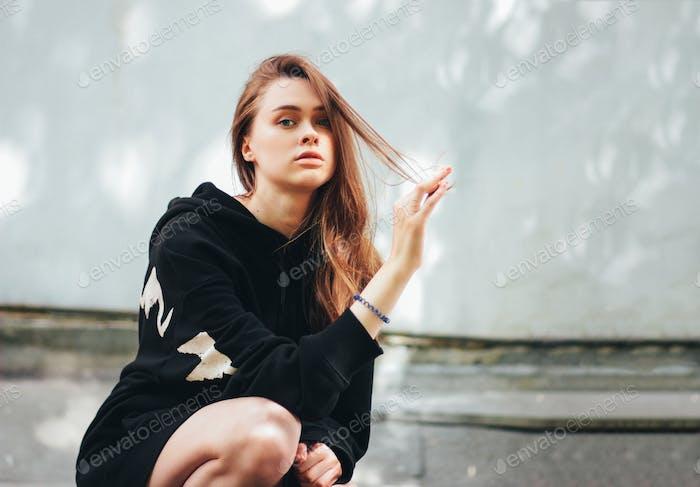Beautiful long hair girl fashion model hipster on city street