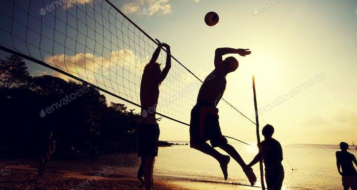 Beach Volleyball at Sunset Enjoyment Concept