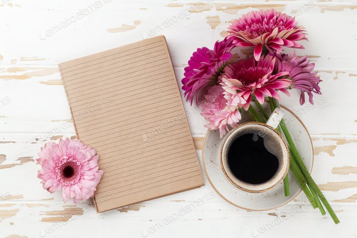 Coffee cup and gerbera flowers