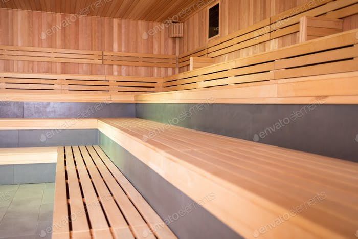 Empty interior of huge sauna in classic wooden finish