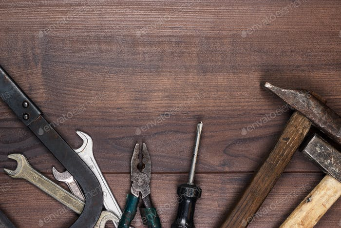 Rusty Construction Tools On The Wooden Background