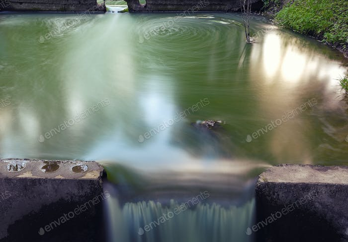 Long exposure of water stream and rocks