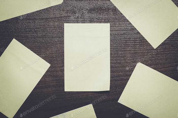 blank stickers on brown wooden table
