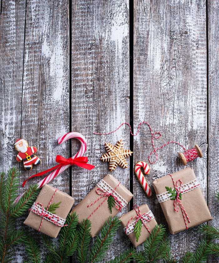 Christmas background with gift boxes and gingerbread cookies