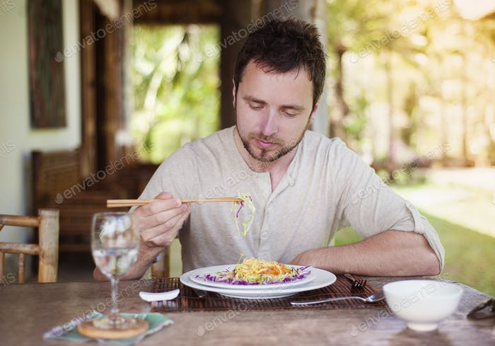 Man enjoying meal at vietnamese restaurant