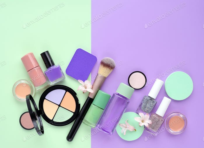 Decorative cosmetics and nail polishes on color background, with
