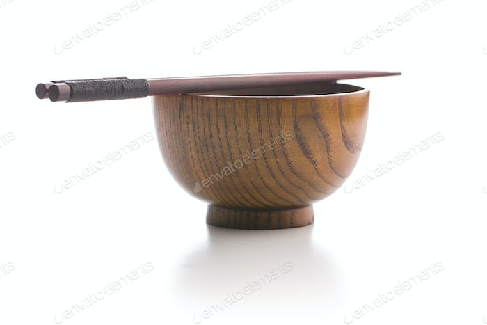 Wooden bowl and chopsticks.