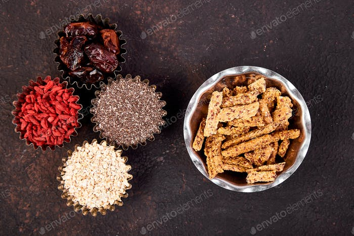 Various superfoods in small bowl near granola
