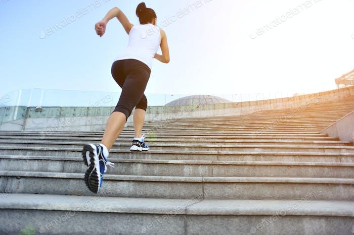 Runner running up on city stairs