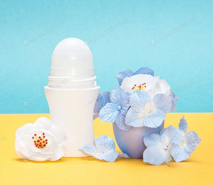 Body antiperspirant deodorant roll-on with flowers in the cap
