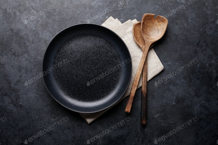 Cooking utensils and empty plate