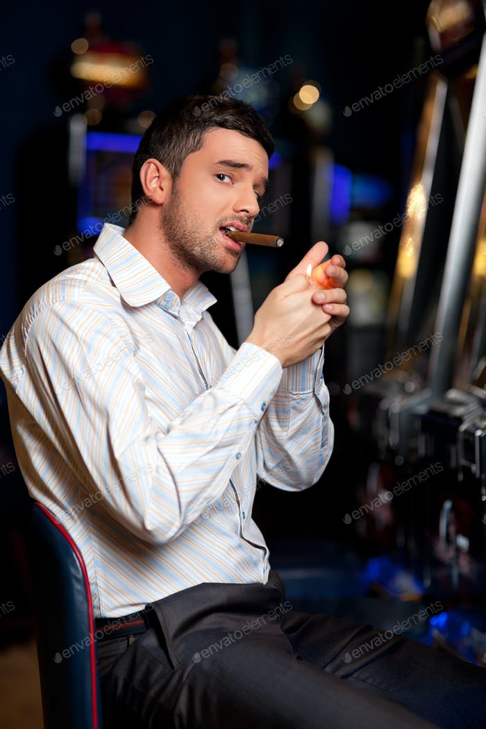 casino player smoking cigar