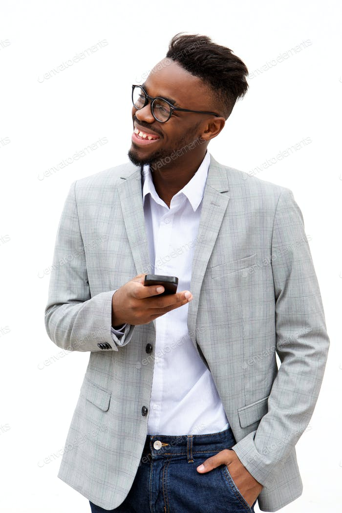 young businessman with mobile phone smiling against white background