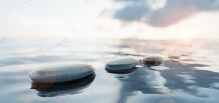 Zen stones on calm water at sunset. Spa wellness and harmony.