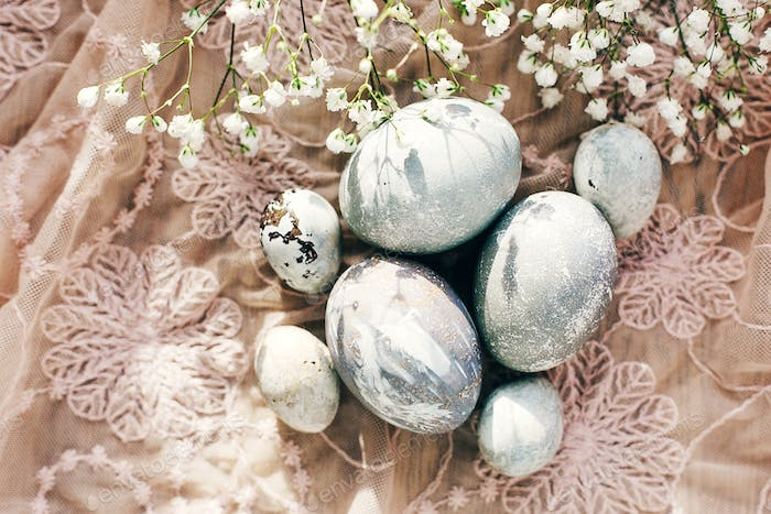 Modern colorful eggs painted with natural dye in grey marble