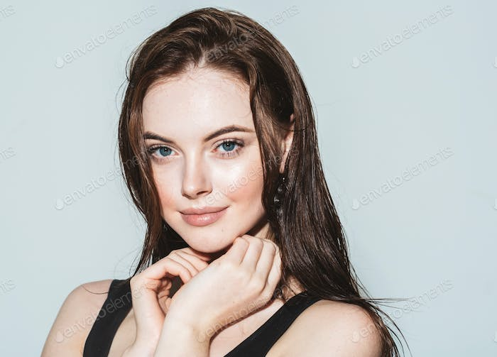 Beautiful Woman Portrait with Perfect makeup Hairstyle. Fashion Model jewelry