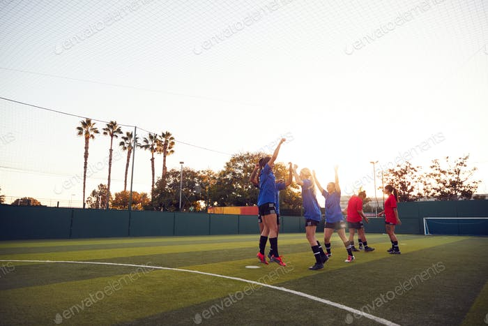 Womens Football Team Celebrating Scoring Goal In Soccer Match On Outdoor Astro Turf Pitch