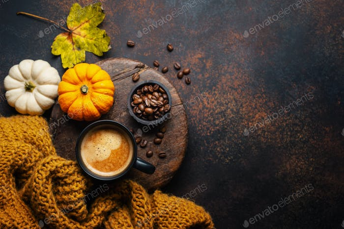 Autumn arrangement with coffee and pumpkin