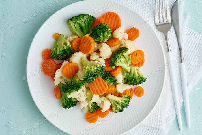 Mix of boiled vegetables. Broccoli, carrots, cauliflower. Steamed vegetables for dietary