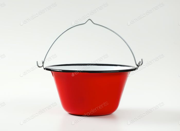 Red and white enamel cauldron / cooking pot with black rim and wire bail handle