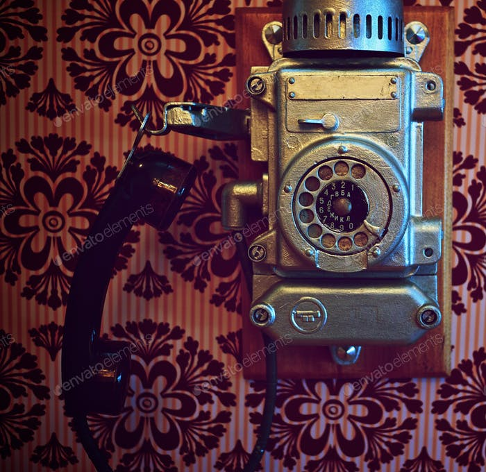 Vintage phone on a wall.