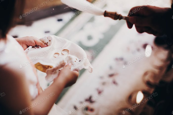 Wedding rings on plate for wedding matrimony in church