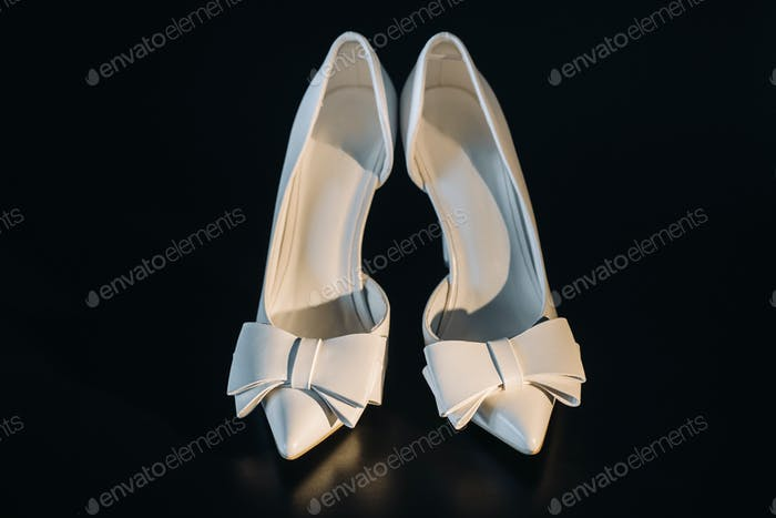 white wedding shoes on a black background