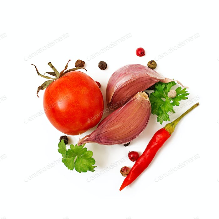 Vegetables and spices: peppers, parsley, garlic and tomatoes. Top view. Isolated on white