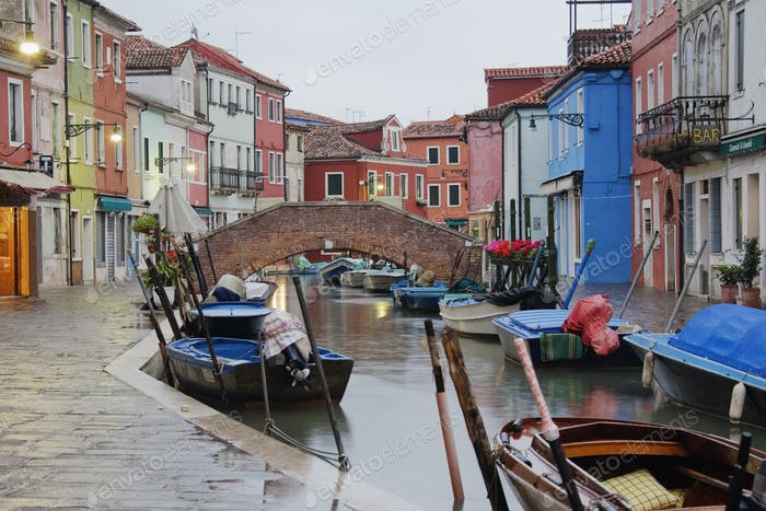 Boats in Burano Canal During a Rain Shower