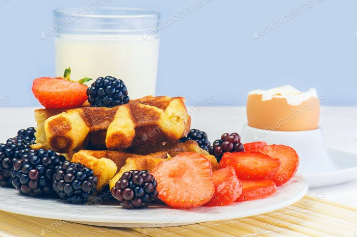 Waffles with fresh berries. Healthy food.