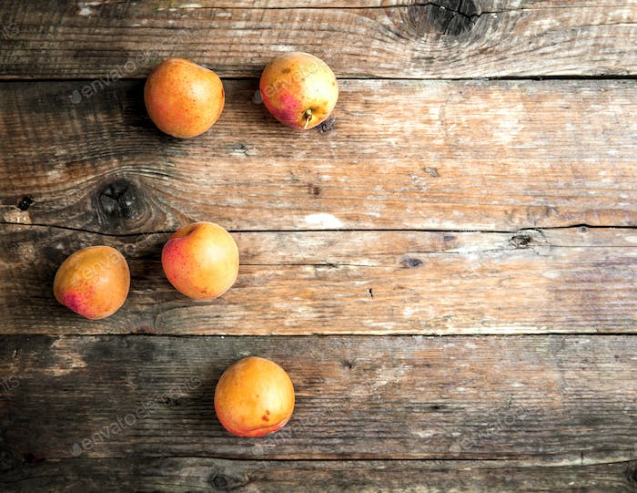 Fresh apricots on wooden background. fruit
