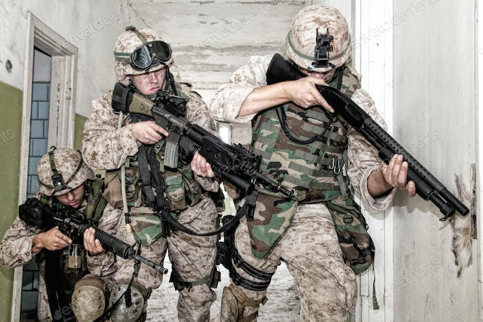Marines clearing rooms with fight in city quarter