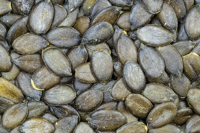 background - many styrian pumpkin hulless seeds