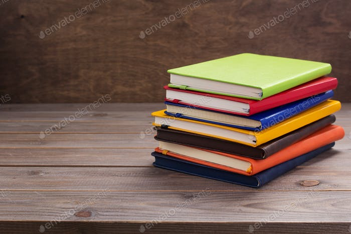 notepad or paper notebook at wooden table