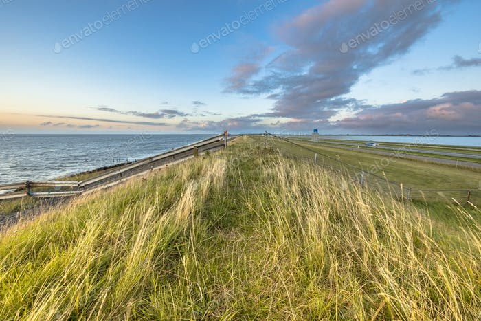 Afsluitdijk dutch dike sunset fences