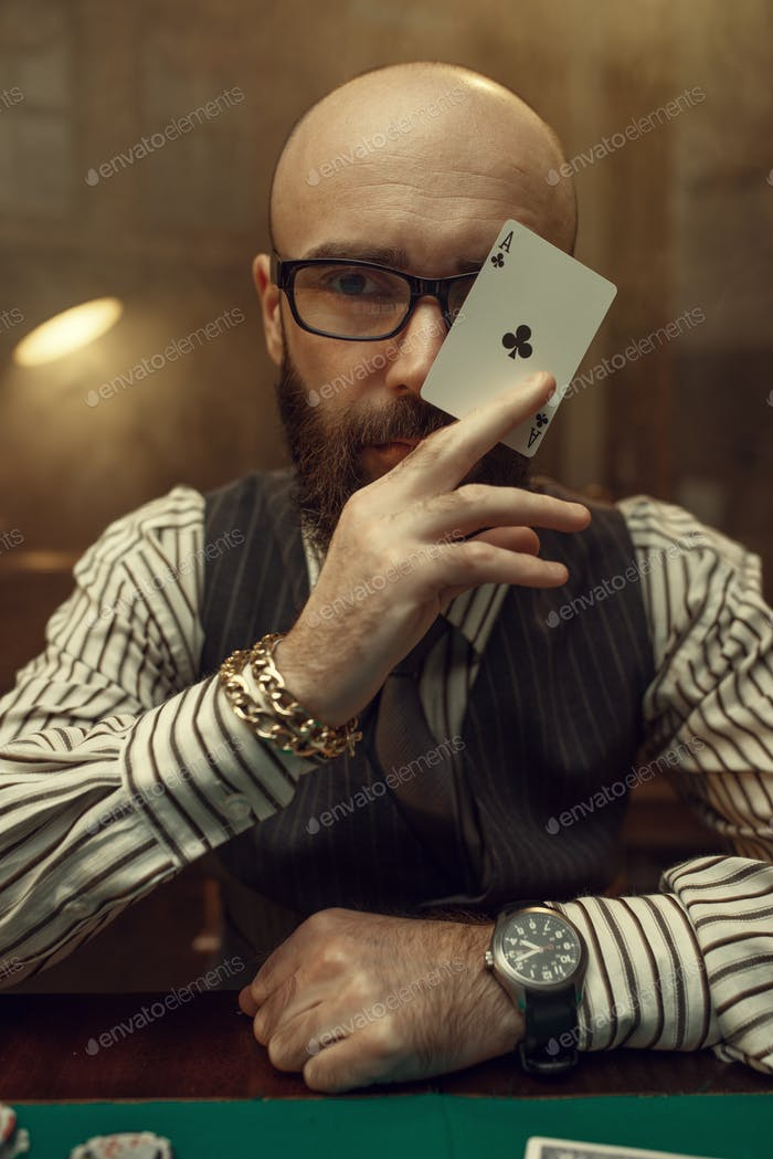 Bearded poker player show ace card, casino