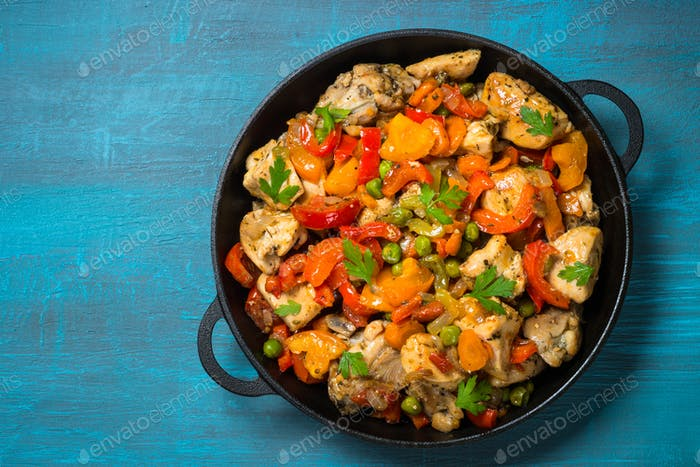 Chicken Stir fry with vegetables on blue table