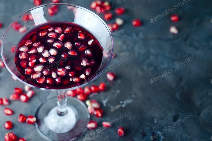 pomegranate cocktail and ripe red pomegranate fruit