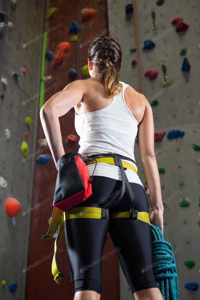 Woman standing with hands on hip in fitness studio