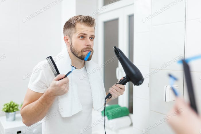 Morning hygiene, Man in the bathroom and his morning routine