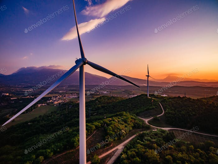 Wind Turbines Windmill Energy Farm at sunset in Italy