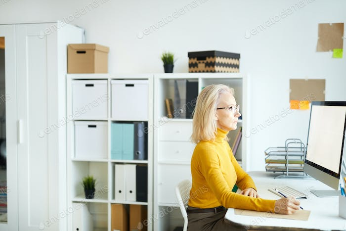 Mature Businesswoman Using Computer