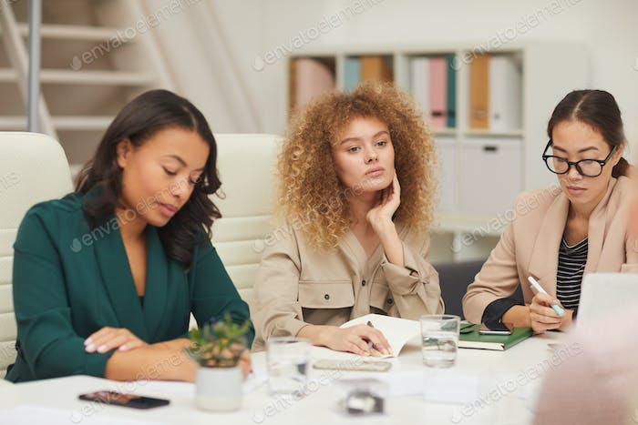 Attentive Businesswomen On Meeting