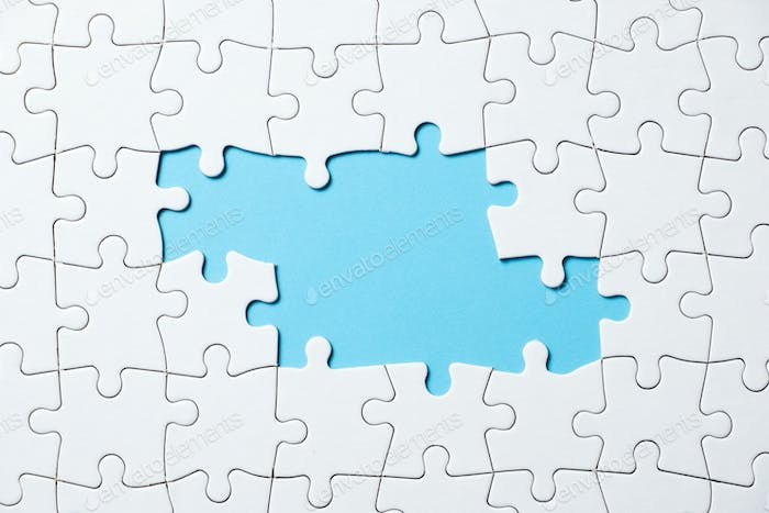 Jigsaw puzzle game piece on blue background for business theme design