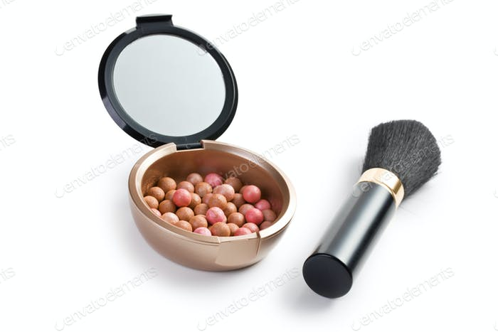 bronzing pearls and makeup brush